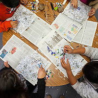 120413       Brian Leddy<br /> Students sort thought piles of shredded paper as part of an Explora activity Wednesday at David Skeets Elementary.