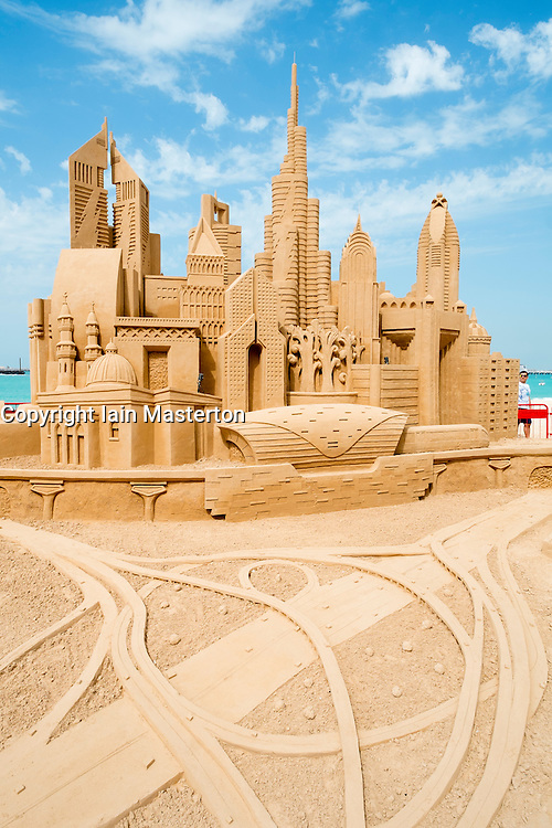 Sand sculpture of skyline of Dubai with many landmark buildings on beach in Dubai United Arab Emirates