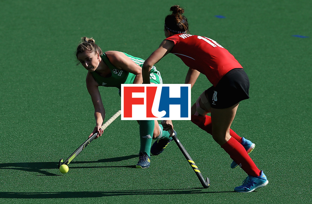 JOHANNESBURG, SOUTH AFRICA - JULY 12: Gillian Pinder of Ireland and Natalia Wisniewska of Poland battle for possession during day 3 of the FIH Hockey World League Semi Finals Pool A match between Ireland and Poland at Wits University on July 12, 2017 in Johannesburg, South Africa. (Photo by Jan Kruger/Getty Images for FIH)