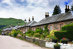 View of historic stone cottages on street in village of Luss in Argyll and Bute Scotland United Kingdom