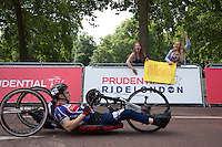 A Hand cyclist finishes the Race on The Mall in front of two keen spectators during The Prudential RideLondon Sunday 2nd August 2015. <br /> <br /> Prudential RideLondon is the world's greatest festival of cycling, involving 95,000+ cyclists – from Olympic champions to a free family fun ride - riding in five events over closed roads in London and Surrey over the weekend of 1st and 2nd August 2015. <br /> <br /> Photo: Paul Gregory<br /> <br /> See www.PrudentialRideLondon.co.uk for more.<br /> <br /> For further information: Penny Dain 07799 170433<br /> pennyd@ridelondon.co.uk