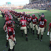 Harvard players enter the field of play before the Harvard Vs Yale, College Football, Ivy League deciding game, Harvard Stadium, Boston, Massachusetts, USA. 22nd November 2014. Photo Tim Clayton