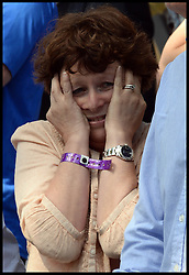 Image ©Licensed to i-Images Picture Agency. 05/07/2014. Yorkshire, United Kingdom.Mark Cavendish's mother Adele watches as her son crashes off his bike in the Tour de Frrance finish line in Harrogate on stage one of the race after a fall  just  short of the finish line . Picture by Andrew Parsons / i-images
