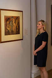 Pictured: Katy Alliosn admires the Three Nudes by John Maxwell.<br /> <br /> The City Art Centre's summer exhibition will cover two floors of the gallery with artworks from William Gillies and John Maxwell. The exhibition will open to the public this weekend as part of the Edinburgh Art Festival 2016<br /> <br /> Ger Harley   EEm 28 July 2016