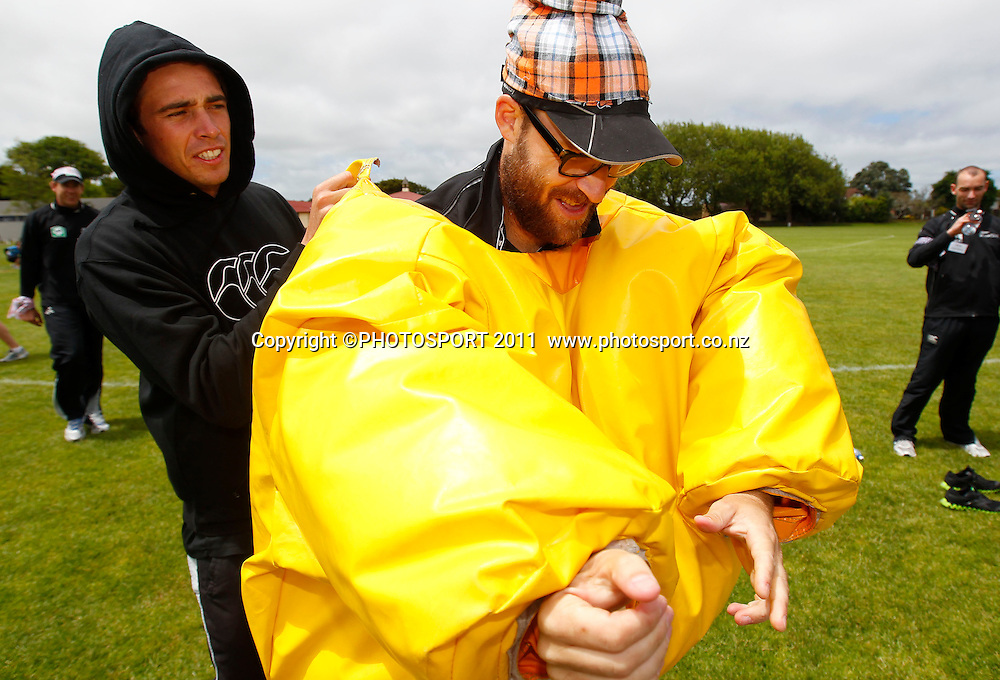 Tim Southee helps Daniel Vettori into a Sumo suit during the HRV Cup Cricket Blackcaps Day, Papatoetoe Recreation Centre, Auckland, 10 November 2011. Photo: Simon Watts / photosport.co.nz