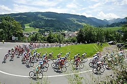 07.07.2011, AUT, 63. OESTERREICH RUNDFAHRT, 5. ETAPPE, ST. JOHANN-SCHLADMING, im Bild das Feld der Fahrer faehrt durch Schladming, dahinter die Planai, die Austragungsort der Alpinen Ski WM 2013 ist // during the 63rd Tour of Austria, Stage 5, 2011/07/07, EXPA Pictures © 2011, PhotoCredit: EXPA/ S. Zangrando