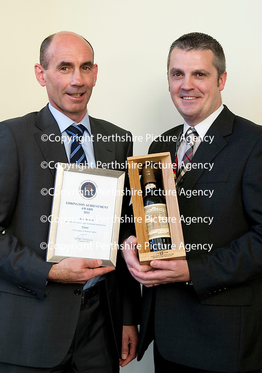 Edrington Achievement Awards....15.12.11<br /> Chief Exec Ian Curle presents an award to Chris Thomson<br /> Picture by Graeme Hart.<br /> Copyright Perthshire Picture Agency<br /> Tel: 01738 623350  Mobile: 07990 594431
