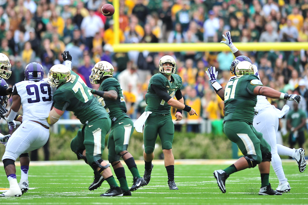 WACO, TX - OCTOBER 11:  Bryce Petty #14 of the Baylor Bears drops back to pass against the TCU Horned Frogs on October 11, 2014 at McLane Stadium in Waco, Texas.  (Photo by Cooper Neill/Getty Images) *** Local Caption *** Bryce Petty