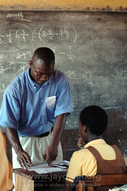 Ghana, Accra, Kokomlemle, 2007. The head teacher at Kwameh Nkrumah Memorial School is also a math instructor, and cares deeply about his students.