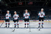 KELOWNA, CANADA - JANUARY 10: Nolan Foote #29, Leif Mattson #28, Cal Foote #25 and Braydyn Chizen #22 of the Kelowna Rockets stand on the blue line as part of the starting line up against the Spokane Chiefs on January 10, 2017 at Prospera Place in Kelowna, British Columbia, Canada.  (Photo by Marissa Baecker/Shoot the Breeze)  *** Local Caption ***