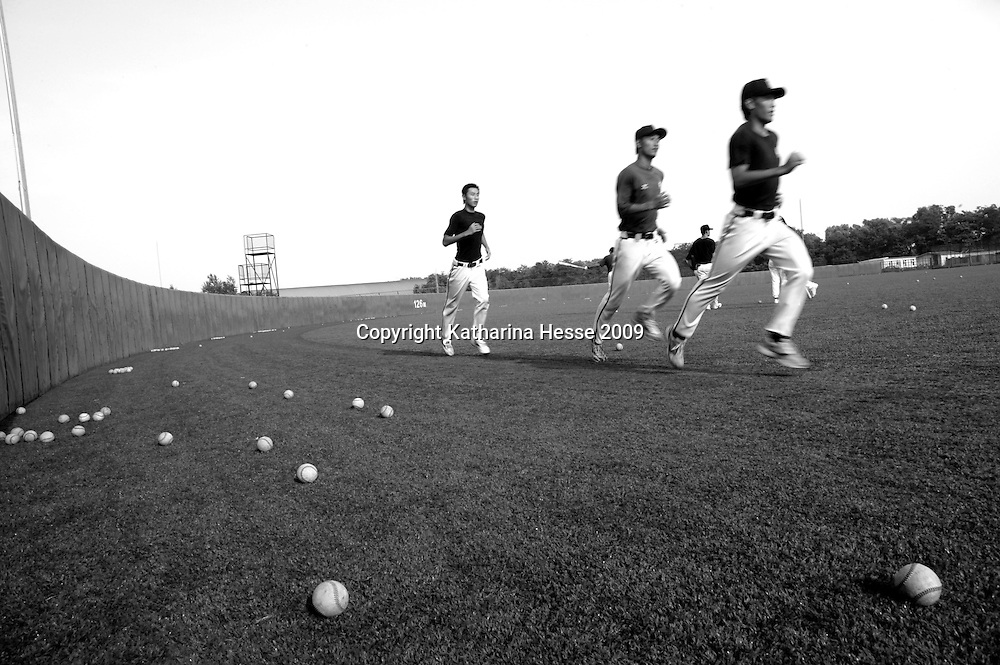 BEIJING, JULY -19:  beijing tiger players warm-up before practise in the field, Beijing, July 19, 2007.