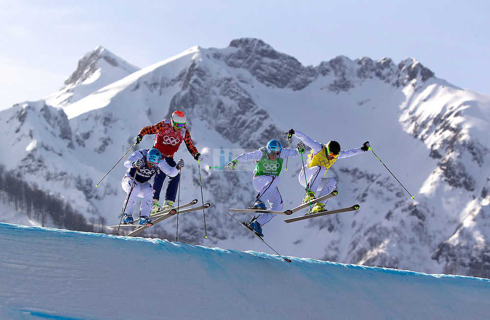 Freestyle Skiing: 2014 Winter Olympics: France Jean Frederic Chapuis (green), France Arnaud Bovolenta (blue), France Jonathan Midol (yellow), and Canada Brady Leman (red) in action during Men's Ski Cross Big Final at Rosa Khutor Extreme Park. Chapuis (green) gold, Bovolenta won silver, and Midol won bronze. Krasnaya Polyana, Russia 2/20/2014 CREDIT: Jed Jacobsohn (Photo by Jed Jacobsohn /Sports Illustrated)