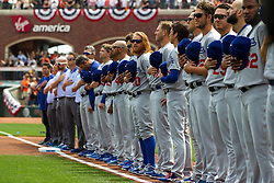 SAN FRANCISCO, CA - APRIL 07:  Members of the Los Angeles Dodgers stand on the field during the national anthem before the game against the San Francisco Giants at AT&T Park on April 7, 2016 in San Francisco, California. The San Francisco Giants defeated the Los Angeles Dodgers 12-6.  (Photo by Jason O. Watson/Getty Images) *** Local Caption ***