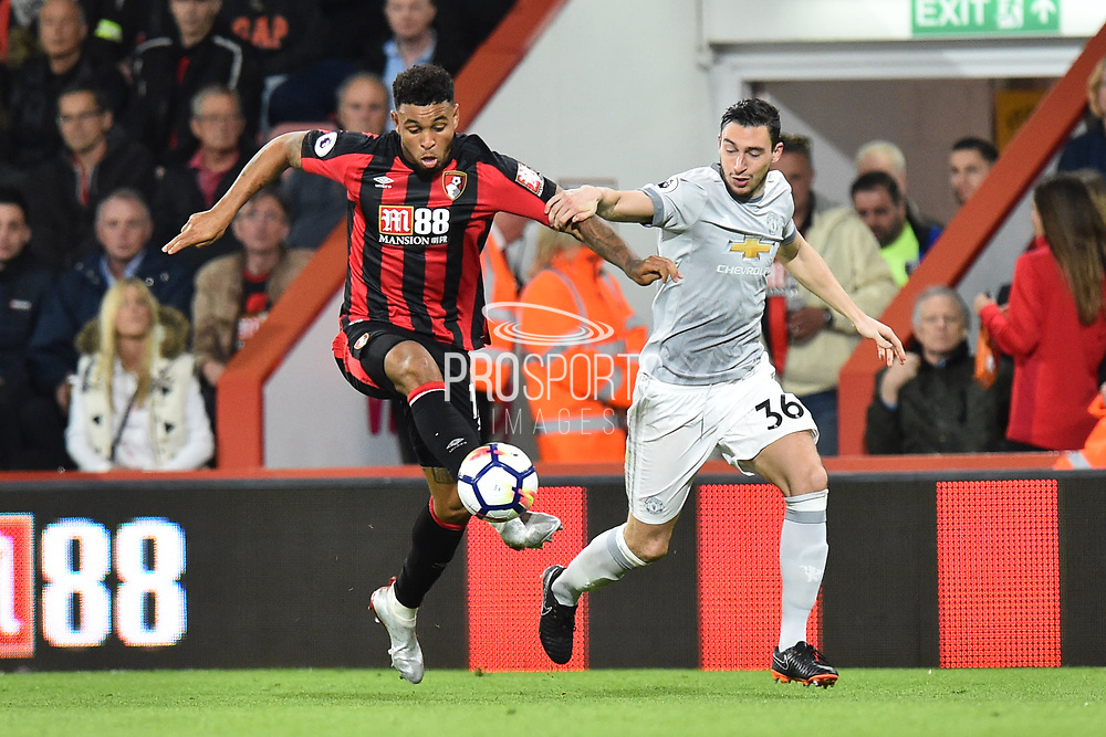 Joshua King (17) of AFC Bournemouth battles for possession with Matteo Darmian (36) of Manchester United during the Premier League match between Bournemouth and Manchester United at the Vitality Stadium, Bournemouth, England on 18 April 2018. Picture by Graham Hunt.