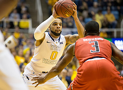 West Virginia Mountaineers guard Jaysean Paige (0) looks to pass against the Texas Tech Red Raiders during the first half at the WVU Coliseum.