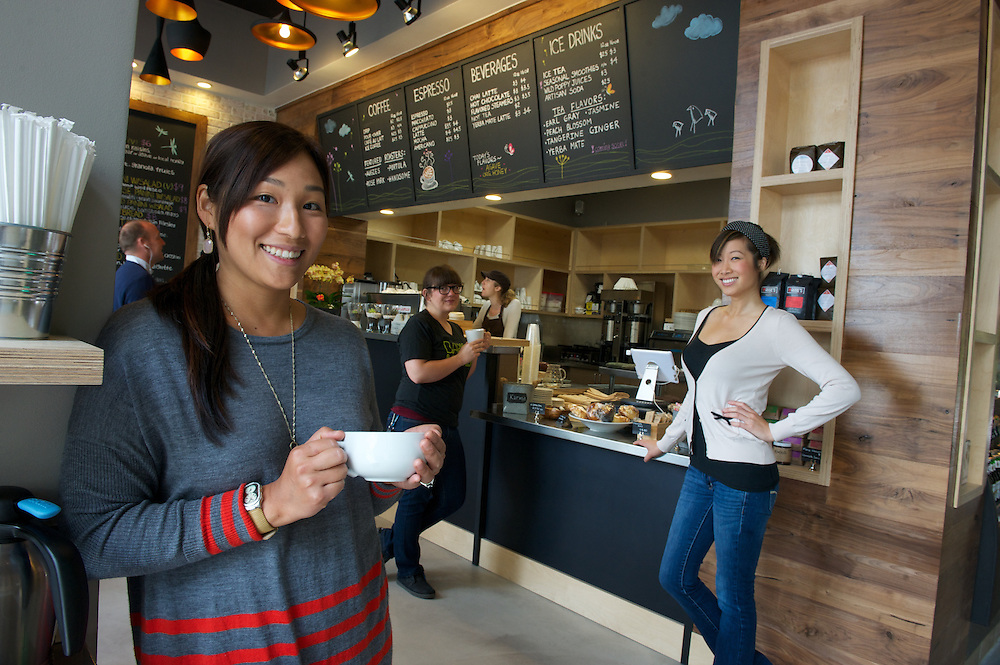 Green Bliss is an eco-friendly coffe house in the center of downtown Fullerton, CA.  Pictured is its owner, Rita Ho, left, and Allison Tan, tallest, and Alex Tran, black shirt.