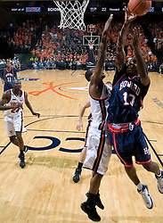 Howard forward Randy Hampton (10) shoots over Virginia guard Sean Singletary (44).  The Virginia Cavaliers men's basketball team faced the Howard Bison at the John Paul Jones Arena in Charlottesville, VA on November 14, 2007.