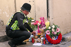 © London News Pictures. 31/03/2015. Police at the scene in Gibraltar where officers discovered the bodies of four individuals, a 31-year-old British male, a 37-year-old Spanish woman, a 4-year-old girl and a 6-week-old girl, all believed to be of the same family. Photo credit: Donovan Torres/LNP