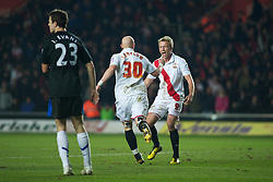 SOUTHAMPTON, ENGLAND - Saturday, January 29, 2011: Manchester United's Jonny Evans looks dejected as Southampton's Richard Chaplow celebrates scoring the opening goal to make it 1-0 during the FA Cup 4th Round match at St. Mary's Stadium. (Photo by Gareth Davies/Propaganda)