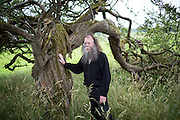 Author and Folklorist Eddie Lenihan amoung the whitethorn trees at Cloonalough Fairy Fort near Crusheen , Co Clare.