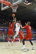 Hartford Hawks guard Cameron McCravy (5) drives for a layup guarded by Hartford Hawks guard Moses Flowers (4), Hunter Marks (0), and PJ Henry (11) during an NCAA college basketball game, Wednesday, Nov. 27, 2019, in Dallas.SMU defeated Hartford 90-58. (Wayne Gooden/Image of Sport)