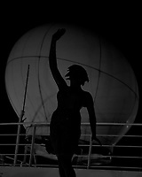 Early morning silhouette of the forward statue against the satellite communication dome from the forward upper deck of the MV World Odyssey. Image taken with a Fuji X-T1 camera and 35 mm f/1.4 lensn (ISO 1600, 35 mm, f/1.4, 1/30 sec).