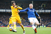 Brighton and Hove Albion midfielder Pascal Gross (13) and Everton striker Wayne Rooney (10) during the Premier League match between Everton and Brighton and Hove Albion at Goodison Park, Liverpool, England on 10 March 2018. Picture by Craig Galloway.
