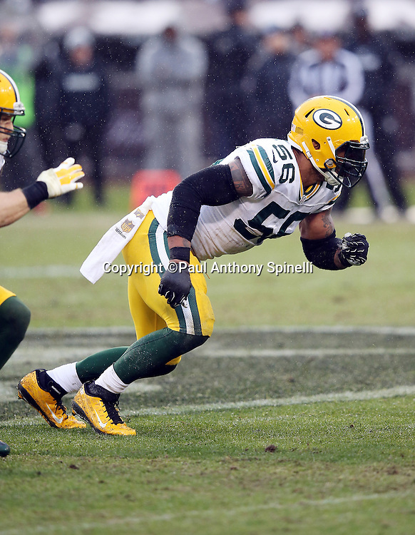 Green Bay Packers outside linebacker Julius Peppers (56) chases the action during the 2015 week 15 regular season NFL football game against the Oakland Raiders on Sunday, Dec. 20, 2015 in Oakland, Calif. The Packers won the game 30-20. (©Paul Anthony Spinelli)