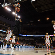 15 March 2018: San Diego State Aztecs forward Malik Pope (21) dunks the ball amid the Houston Cougars defense in the first half. The San Diego State Aztecs got knocked out in the first round by Houston on a last second layup to lose 67-65  at Intrust Bank Arena in Wichita, Kansas.