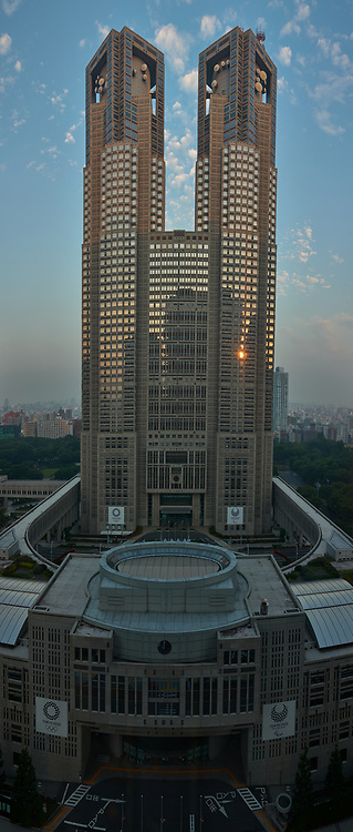 Reflections of the Sun Rising. Tokyo Metropolitan Government Building from the Keio Plaza Hotel. Composite of six images taken with a Leica CL camera and 23 mm f/2 lens. Raw images processed with Capture One Pro and AutoPano Giga Pro.