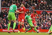 Sunderland defender Patrick Van Aanholt   blocks Liverpool midfielder Roberto Firmino  shot during the Barclays Premier League match between Liverpool and Sunderland at Anfield, Liverpool, England on 6 February 2016. Photo by Simon Davies.