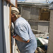 MARATHON, FL - SEPTEMBER 16: <br /> Tim Thompson, Minister of the Marathon Church of Christ,  inspects the house he rents next to his church after arriving from Homestead where he and his wife evacuated to before Hurricane Irma made landfall. They rent a house next to the church on September 16, 2017 in Marathon, Florida.  (Photo by Angel Valentin/Getty Images)
