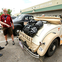 Manuel Dubs and Joe Dillier, both from Switzerland, talk about Dillier's car, a 1930 Chrysler 70 Roadster, upon their arrivial from Memphis to the Tupelo Automobile Museum on Friday morning. Both Dubs and Dillier, are part of 39 cars taking part in The Endurance Rally Association's , The Trans America Challenge 2018. The rally started on May 27 in Charleston South Carolina and will end in Seattle on Sunday June 17. The drivers stopped in Tupelo for lunch, rest and a quick tour of the Tupelo Automobile Museum.