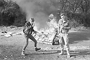 Horgan and Symond with burning sofa, UK,  1980s.