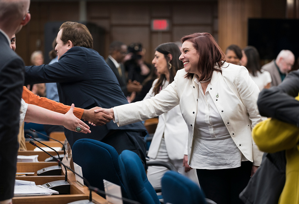 Incoming Alders shake hands after being sworn in at the City County Building in Madison, WI on Tuesday, April 16, 2019.
