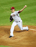 Jul. 15 2011; Phoenix, AZ, USA; Arizona Diamondbacks pitcher Joe Saunders (34) delivers a pitch during the first inning against the Los Angeles Dodgers at Chase Field. The Dodgers defeated the Diamondbacks 6-4. Mandatory Credit: Jennifer Stewart-US PRESSWIRE.
