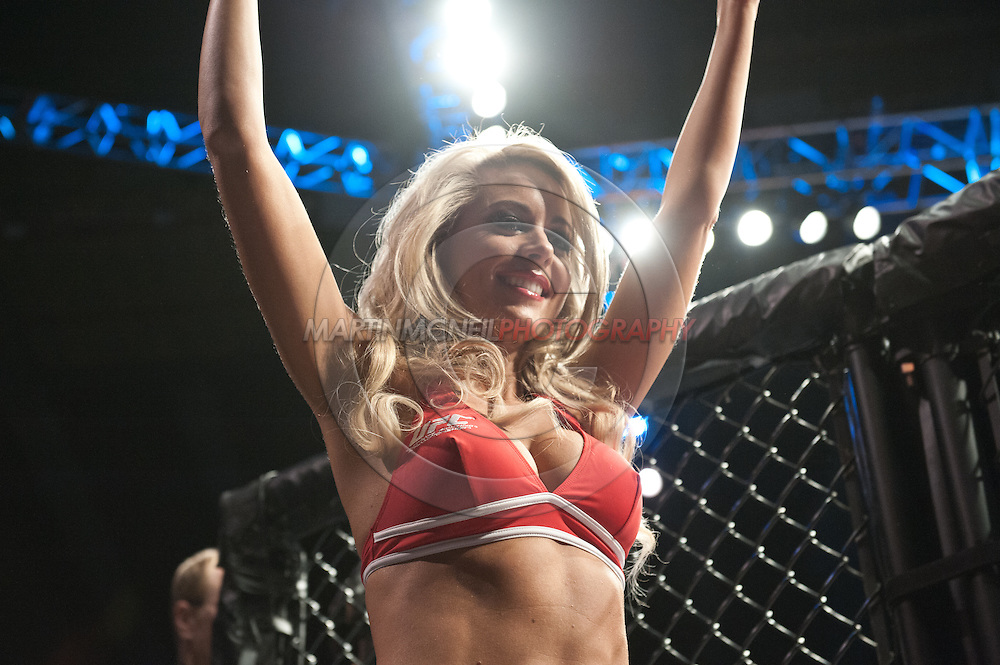 "LONDON, ENGLAND, FEBRUARY 16, 2013: Carly Baker walks on the cage apron during ""UFC on Fuel TV 7: Barao vs. McDonald"" inside Wembley Arena in Wembley, London on Saturday, February 16, 2013 (© Martin McNeil)"
