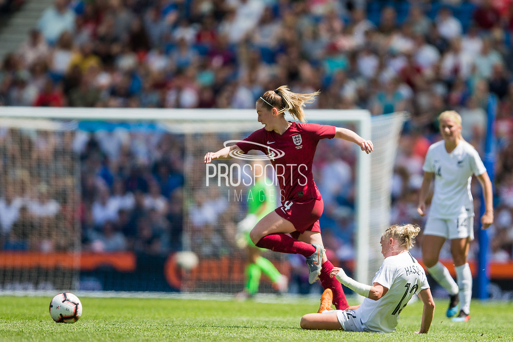 Keira Walsh (England) jumping over Betsy Hassett (New Zealand) during the FIFA Women's World Cup UEFA warm up match between England Women and New Zealand Women at the American Express Community Stadium, Brighton and Hove, England on 1 June 2019.
