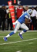Detroit Lions running back Reggie Bush (21) runs the ball in the second quarter during the NFL week 18 NFC Wild Card postseason football game against the Dallas Cowboys on Sunday, Jan. 4, 2015 in Arlington, Texas. The Cowboys won the game 24-20. ©Paul Anthony Spinelli