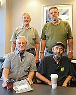 Richard Hrvol (from left), of Cedar Rapids, Roger Wiest, of Cedar Rapids, Doug Adamson, of Center Point, and Jay Kaiser, of Cedar Rapids, at Wells Fargo Bank in Cedar Rapids on Tuesday, July 16, 2013.