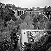 Small formal garden provides a great vantage point into the Petrusse valley and the Adolphe Bridge.  The garden was formally part of the massive defensive wall system protecting the city (B&W version)