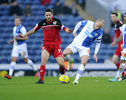 Bristol City's Cole Skuse battles for the ball with Blackburn Rovers' Danny Murphy - Photo mandatory by-line: Joe Meredith/JMP  - Tel: Mobile:07966 386802 05/01/2013 - Blackburn Rovers v Bristol City - SPORT - FOOTBALL - FA Cup -  BLACKBURN - EWOOD PARK -