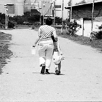 Living in a camp means that you are leaving behind all your privacy. Everything is shared with everybody...During the summer1999, over 245,000 Serbs and Roms fled to Serbia and Montenegro from or within Kosovo in fear of reprisals from the majority Albanian population, after NATO air strikes had forced the withdrawal of Yugoslav. In 2003, less than 2% of them had returned and a large number of these internally displaced persons (IDPs) were still living in camps in very difficult conditions..In addition, around 5,000 IDPs, mainly of Roma ethnicity, are living in unrecognized collective centres, makeshift huts, corrugated metal containers and other substandard shelters. .This work was meant to look at how the life of children and young adults is affected by the fact that they are IDPs. I asked myself more specifically what would be different for these children/young adults from the 'normal' people of their age as far as education, health,  social life, family, 'love' life and leisure are concerned. ..Vivre dans un camp veut dire que la vie privée n'existe plus. Tout est partagée avec tout le monde...Pendant l'été 1999, plus de 245 000 serbes et roms ont fuit le Kosovo pour chercher refuge en Serbie ou au Montenegro, par peur de représailles de la part de la majorité de la population albanaise après que les forces de l'OTAN aient forcé l'armée yougoslave à se retirer. En 2003, moins de 2% d'entre eux étaient rentrés chez eux et le plus grand nombre de ces 'déplacés' (IDPs) vivaient encore dans des centres d'accueil dans des conditions très difficiles..Environ 5 000 IDPs, la plupart romas, vivent dans des centres non reconnus faits de containers ou d'abris de fortune. .Ce travail s'est focalisé sur les jeunes IDPs, sur les conséquences de leur état de 'déplacés' sur leur vie et plus particulièrement dans les sphères concernant l'éducation, la vie sociale, la vie de famille, la vie amoureuse et les loisirs..