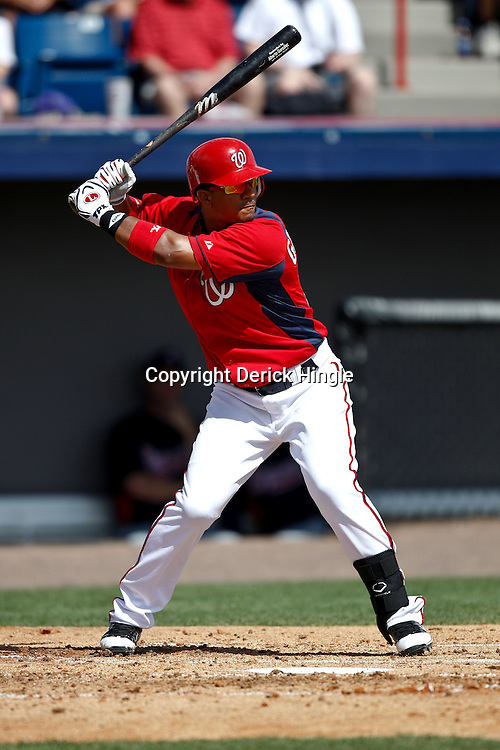 March 4, 2011; Viera, FL, USA; Washington Nationals second baseman Alberto Gonzalez (12) during a spring training exhibition game against the Atlanta Braves at Space Coast Stadium.  Mandatory Credit: Derick E. Hingle