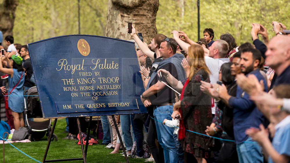 © Licensed to London News Pictures. 22/04/2019. LONDON, UK.  Members of the public watch the King's Troop Royal Horse Artillery take part in a 41 gun salute in Hyde Park to mark the 93rd birthday of Her Majesty The Queen.  Six First Wold War-era 13-pounder Field Guns are used to fire blank artillery rounds..  Photo credit: Stephen Chung/LNP
