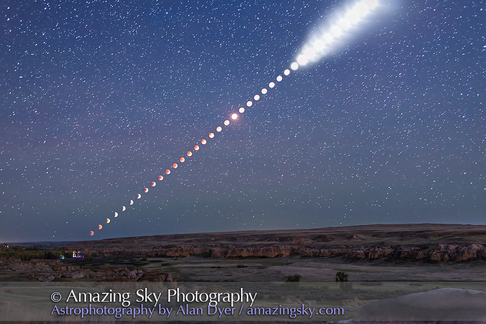 This is a multiple-exposure composite of the total lunar eclipse of Sunday, September 27, 2015, as shot from Writing-on-Stone Provincial Park, Alberta, Canada. <br /> <br /> From this location the Moon rose in the east at lower left already in partial eclipse. As it rose it moved into Earth&rsquo;s shadow and became more red and the sky darkened from twilight to night, bringing out the stars. Then, as the Moon continued to rise higher it emerged from the shadow, at upper right, and returned to being a brilliant Moon again, here overexposed and now illuminating the landscape with moonlight.<br /> <br /> The disks of the Moon become overexposed here as the sky darkened because I was setting exposures to show the sky and landscape well, not just the Moon itself. That&rsquo;s because I shot the frames used to assemble this multiple-exposure still image primarily for use as a time-lapse movie where I wanted the entire scene well exposed in each frame. <br /> <br /> Indeed, for this still image composite of the eclipse from beginning to end, I selected just 40 frames taken at 5-minute intervals, out of 530 I shot in total, taken at 15- to 30-second intervals for the full time-lapse sequence. <br /> <br /> All were taken with a fixed camera, a Canon 6D, with a 35mm lens, to nicely frame the entire path of the Moon, from moonrise at left, until it left the frame at top right, as the partial eclipse was ending.<br /> <br /> The ground comes from a blend of 3 frames taken at the beginning, middle and end of the sequence, so is partly lit by twilight, moonlight and starlight. Lights at lower left are from the Park&rsquo;s campground.<br /> <br /> The sky comes from a blend of 2 exposures: one from the middle of the eclipse when the sky was darkest and one from the end of the eclipse when the sky was now deep blue. The stars come from the mid-eclipse frame, a 30-second exposure. <br /> <br /> PLEASE NOTE: The size of the Moon and its path across the sky are accurate here, because all the images for this composite were taken with the same lens using a camera that did not m
