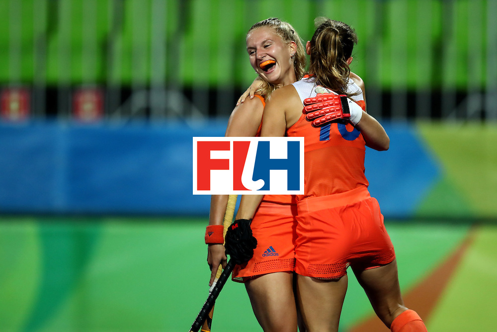 RIO DE JANEIRO, BRAZIL - AUGUST 08:  Laurien Leurink #6 and Kelly Jonker #10 of Netherlands celebrate a goal against Korea during a Women's Pool A match on Day 3 of the Rio 2016 Olympic Games at the Olympic Hockey Centre on August 8, 2016 in Rio de Janeiro, Brazil.  (Photo by Sean M. Haffey/Getty Images)