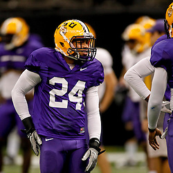 January 5, 2012; New Orleans, LA, USA; LSU Tigers cornerback Tyrann Mathieu wearing (24) talks during practice with safety Craig Loston (6) for the 2012 BCS National Championship game to be played on January 9, 2012 against the Alabama Crimson Tide at the Mercedes-Benz Superdome.  Mandatory Credit: Derick E. Hingle-US PRESSWIRE