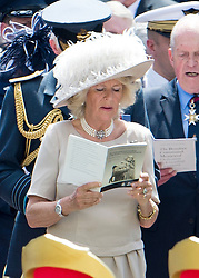 © London News Pictures. 28/06/2012.  London, UK. Camilla, The Duchess or Cornwall singing during a service held for the unveiling of a new £3.5m Bomber Command Memorial in Green Park, London dedicated to the 55,573 airmen who died in the Second World War. The pavilion, made of Portland Stone stands at over 8m tall with an open roof. The entrance is made from melted down aluminium sections of a Halifax bomber shot down during the war and in which all seven of the crew were killed. The memorial includes inscriptions from Winston Churchill. Photo credit: Ben Cawthra/LNP