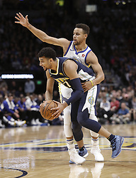 November 4, 2017 - Denver, Colorado, U.S - Nuggets JAMAL MURRAY, bottom, gets held back by Warriors STEPHEN CURRY, top, during the 1st. Half at the Pepsi Center Saturday night. The Nuggets lose to the Warriors 127-108. (Credit Image: © Hector Acevedo via ZUMA Wire)